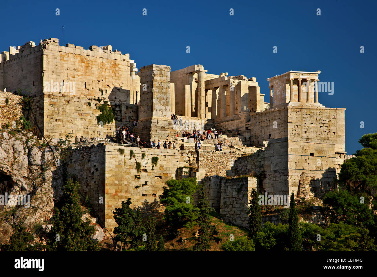The Propylaea of the Acropolis of Athens with the temple of Athena Nike on the upper right side. Athens, Gree - Stock Image