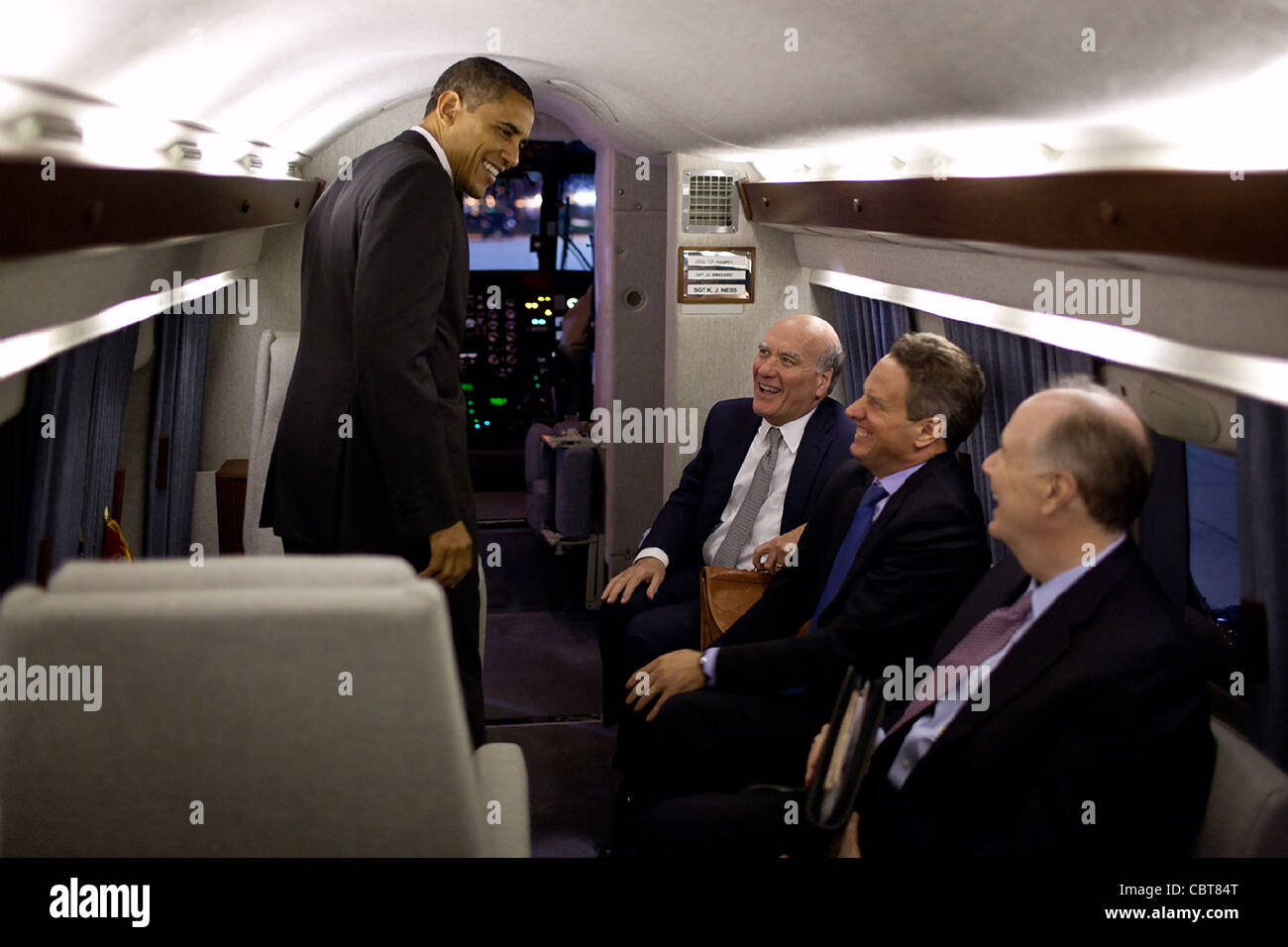 President Barack Obama talks with Chief of Staff Bill Daley, Treasury Secretary Timothy Geithner, and National Security - Stock Image