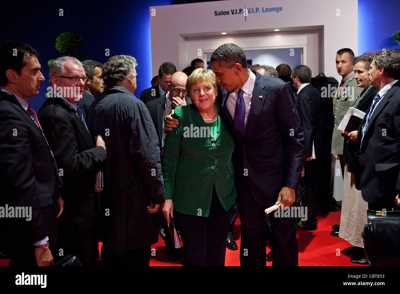 President Barack Obama walks with German Chancellor Angela Merkel after a meeting with Eurozone leaders at the G20 - Stock Image