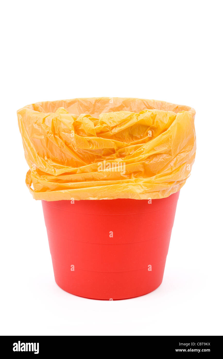 Red Garbage can with white background - Stock Image