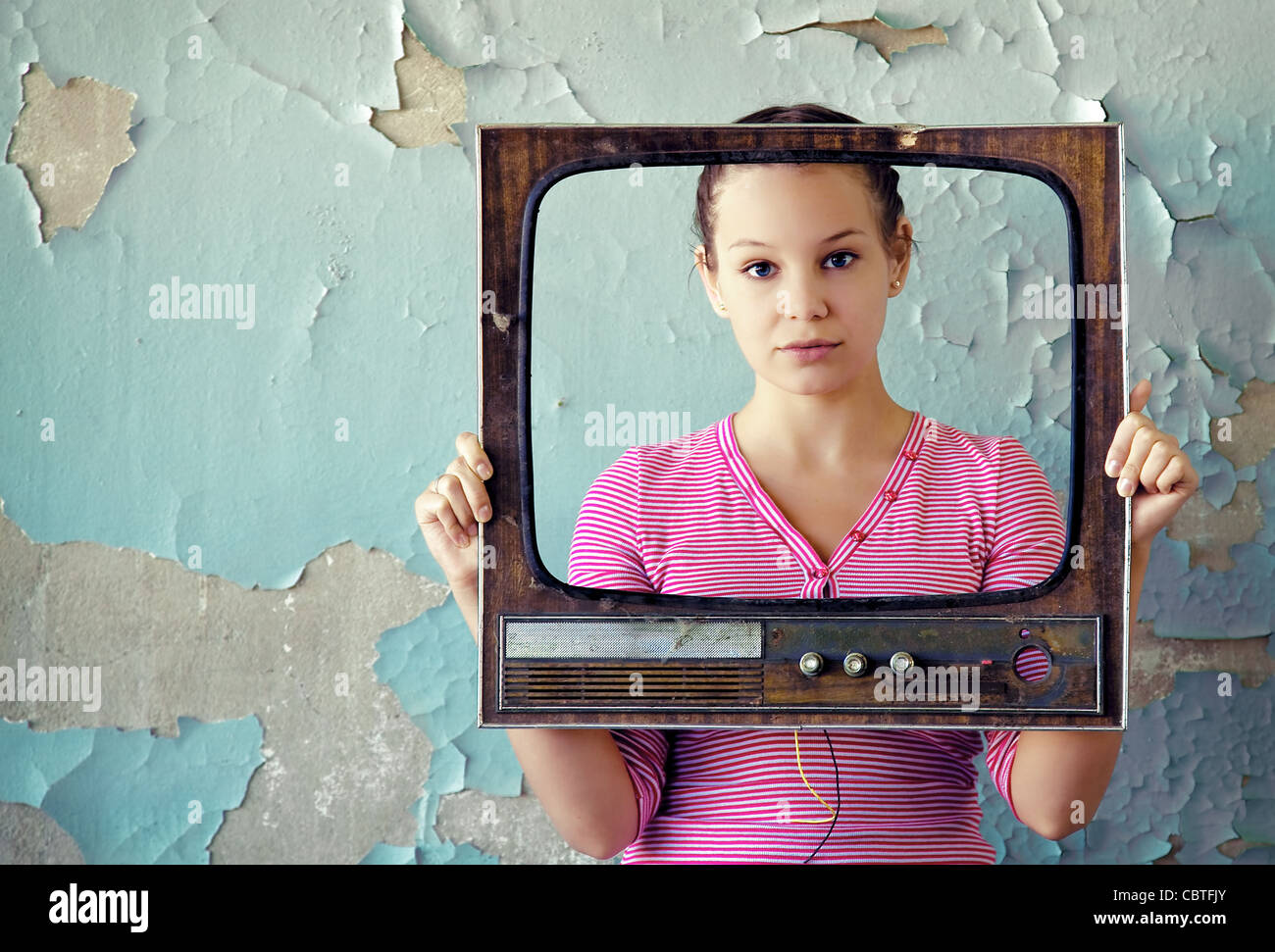woman with old tv frame - Stock Image