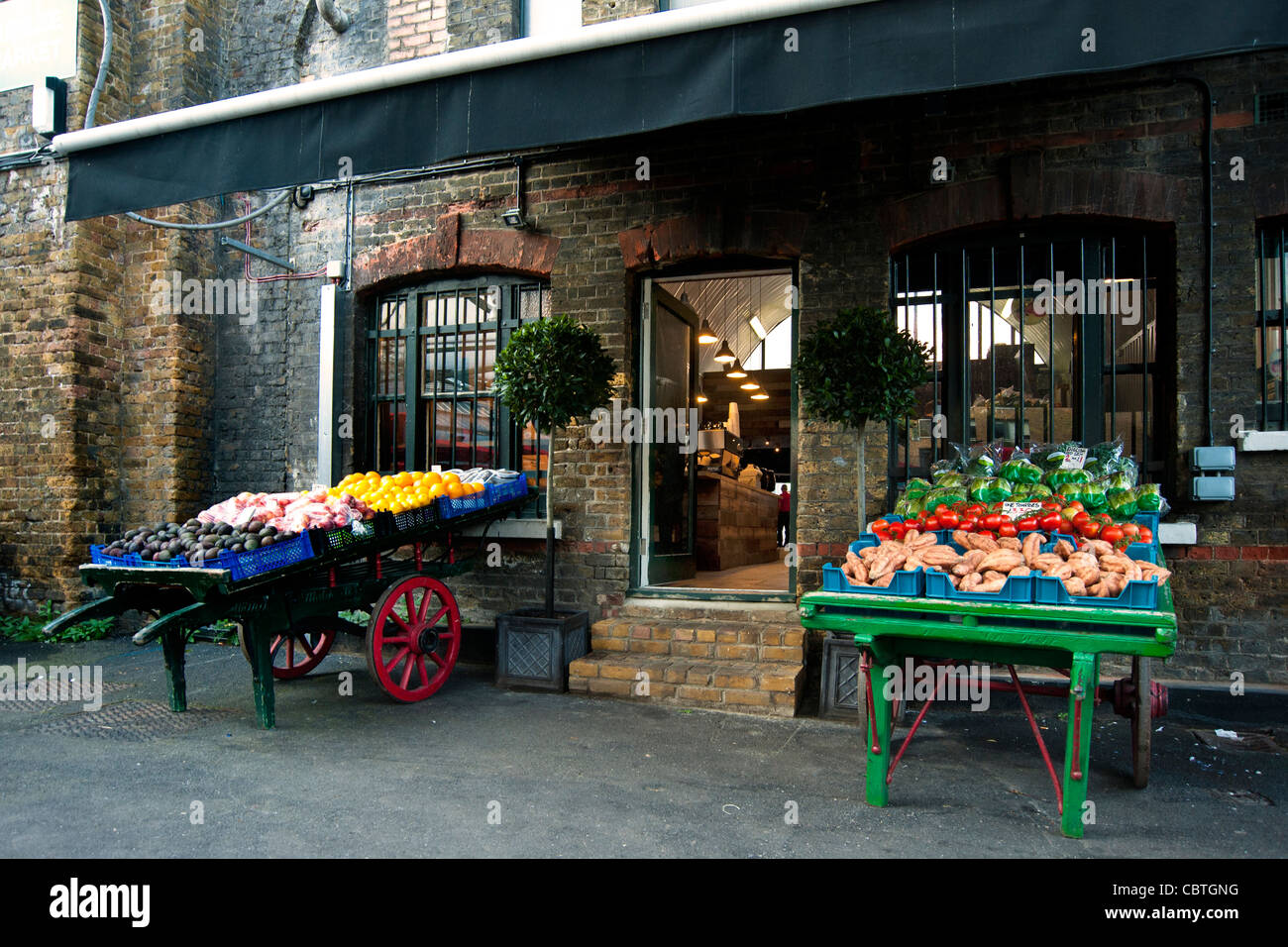 Pretty Fruit and Vegetable Stalls at Borough Farmers Market, London - Stock Image
