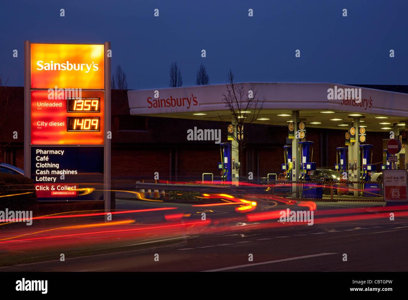 Sainsburys Fuel Garage forecourt at night, england, europe - Stock Image