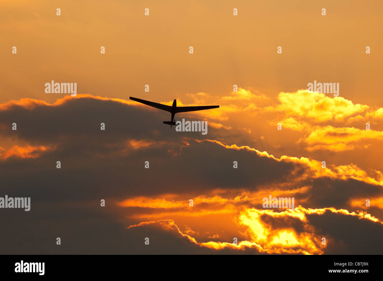 ASK13 Glider launching at sunset, Crusaders Gliding Club,  Kingsfield Airstrip, Dhekelia, Cyprus. - Stock Image