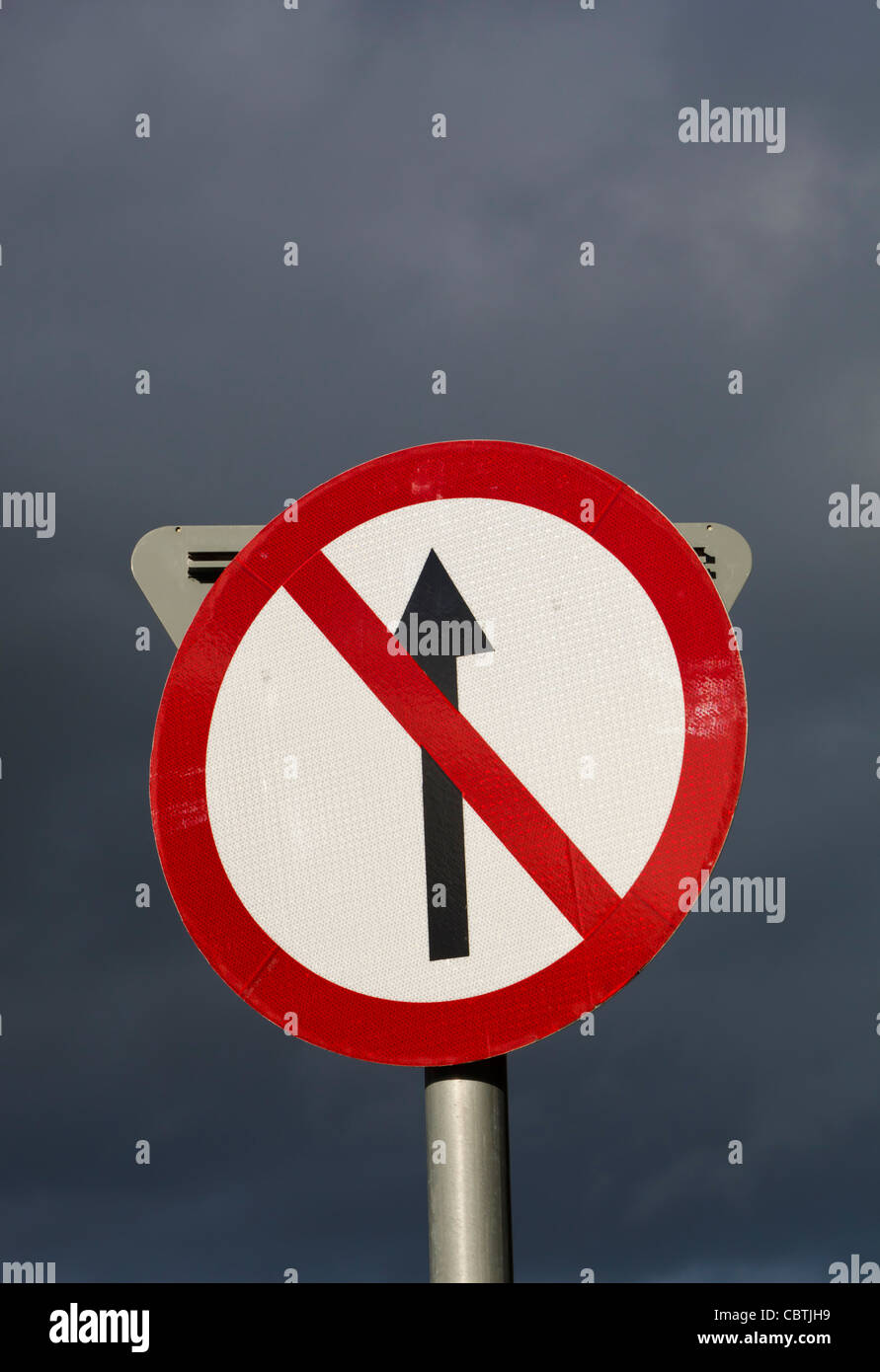 No Entry traffic sign against stormy sky, Clonakilty, County Cork, Republic of Ireland. - Stock Image