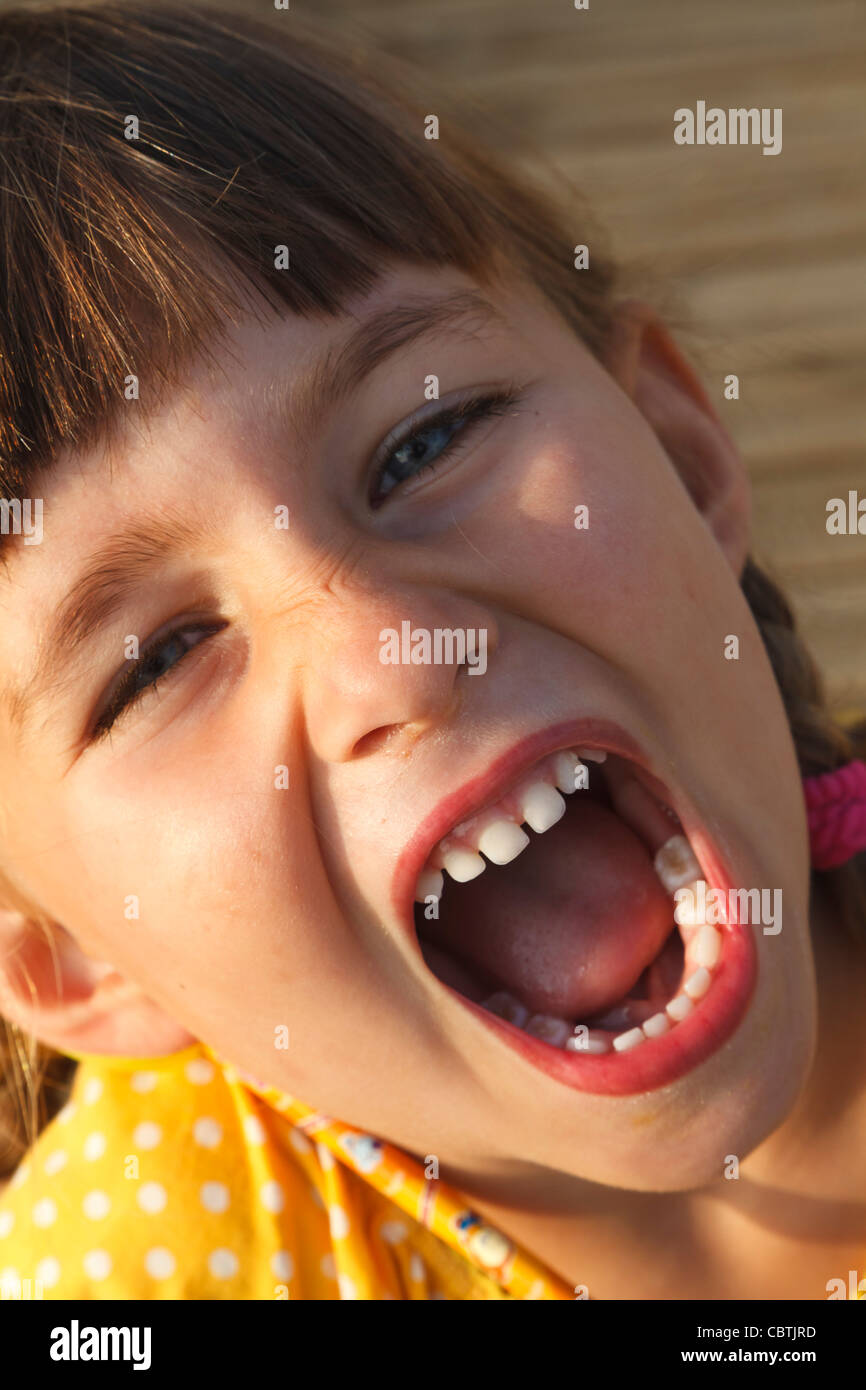 Four year old girl shouting with joy - Stock Image