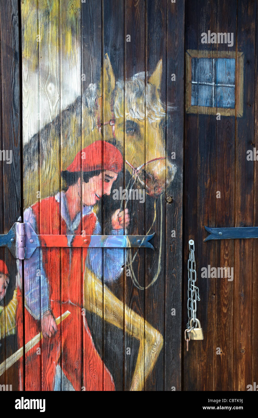 Painted Garage, Stables or Barn Door with Painted Horse, Roubion, Alpes-Maritimes, France - Stock Image