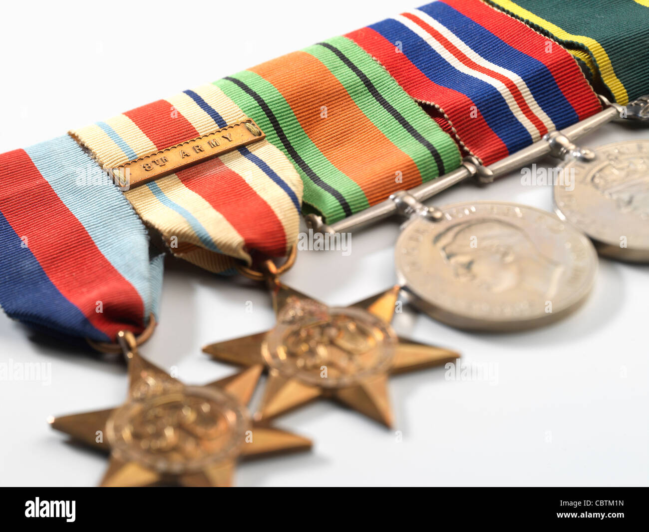 Medals awarded during WW2, including the 8th Army Africa Star, The Defence Medal, and The Territorial Army Medal. - Stock Image