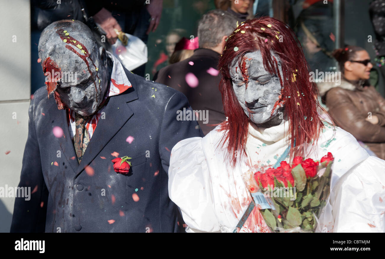 A man and a woman disguised in gothic fancy dresses painted as undeads at the carneval in Sion Wallis Valais - Stock Image