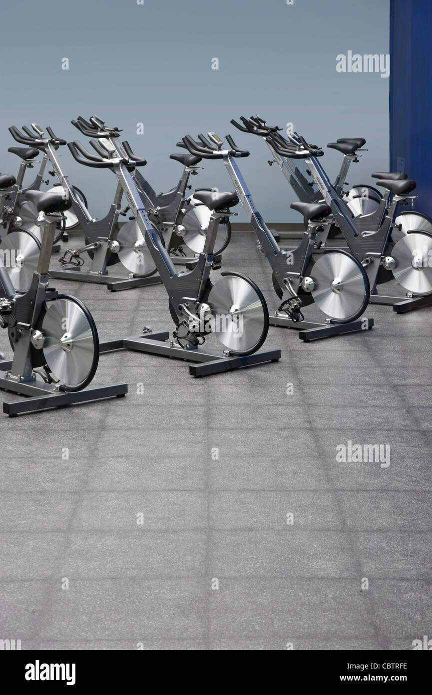 Spinning Stationary Bikes, Fitness Center - Stock Image
