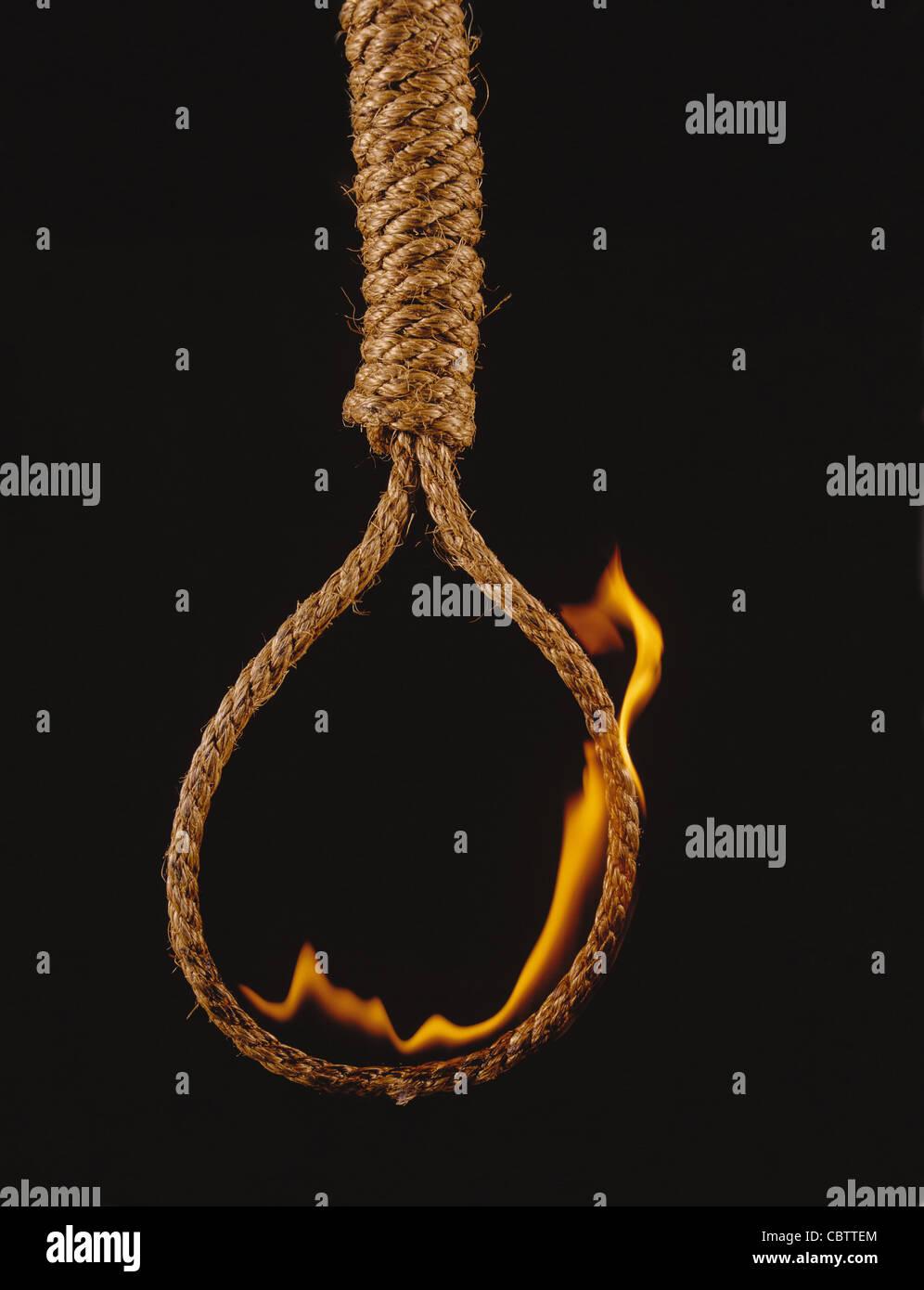 Hangman's noose on fire - Stock Image