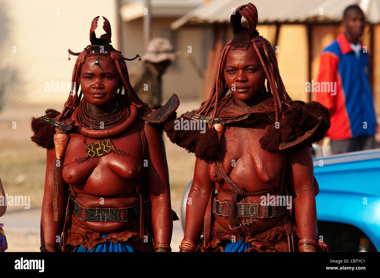 Himbas in the street of Opuwo town, Kunene region, northern Namibia - Stock Image