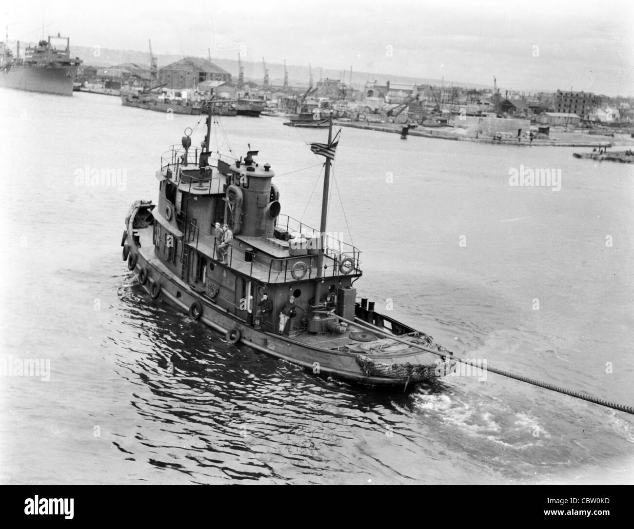 Tug Boat Pulling Ship In Waters Near England During WWII
