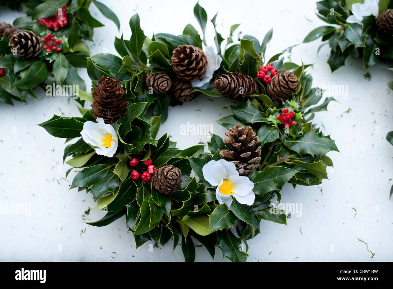 Traditional Hand Made Christmas Holly Wreaths On Sale At A Farmers Market Uk
