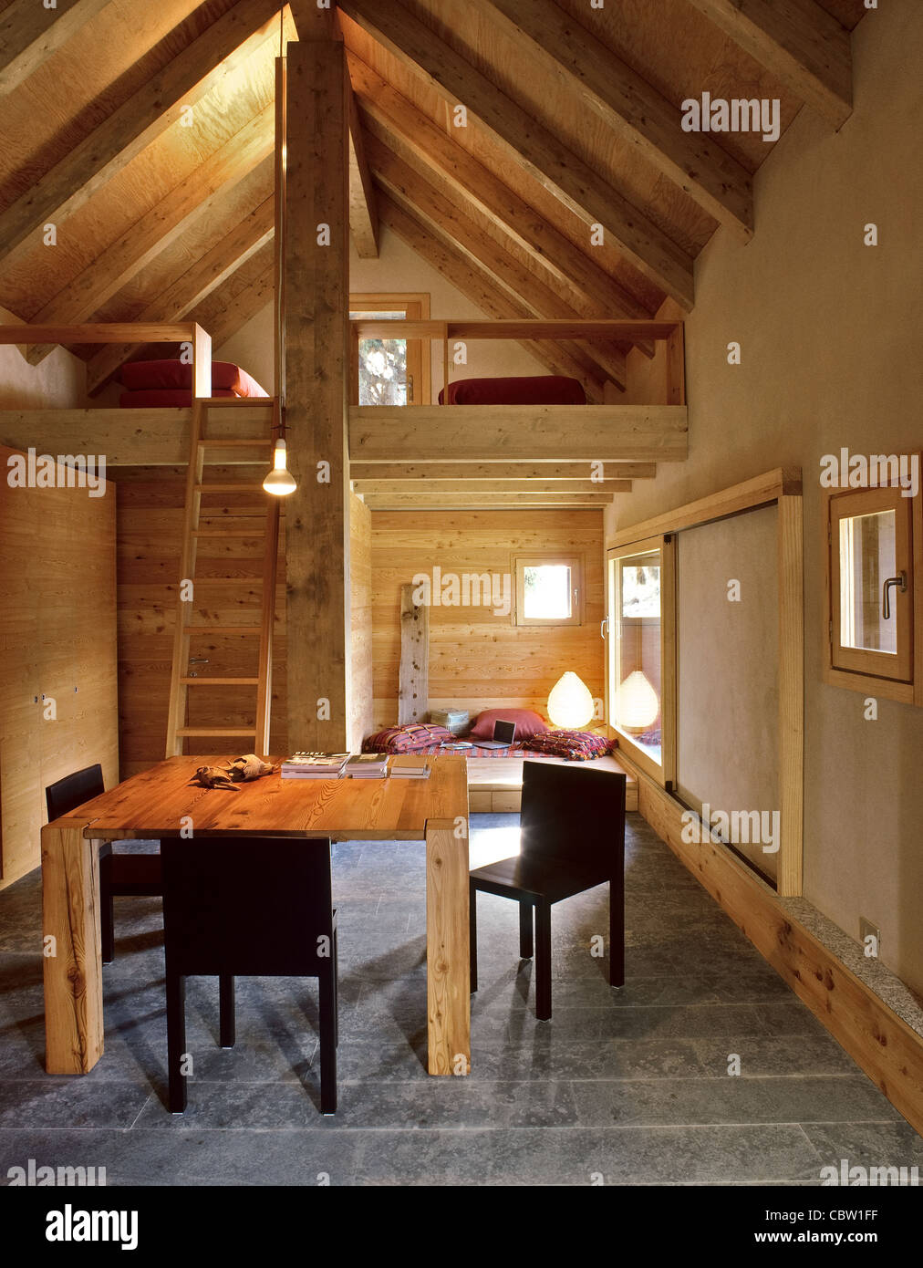 Interior Of Chalet With Dining Table And Sleeping Loft Stone Floor - Wood and stone dining table