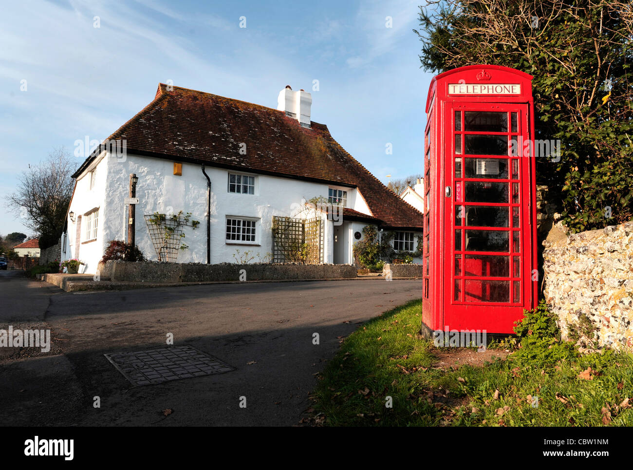 Red telephone box in Piddinghoe village, East Sussex - Stock Image