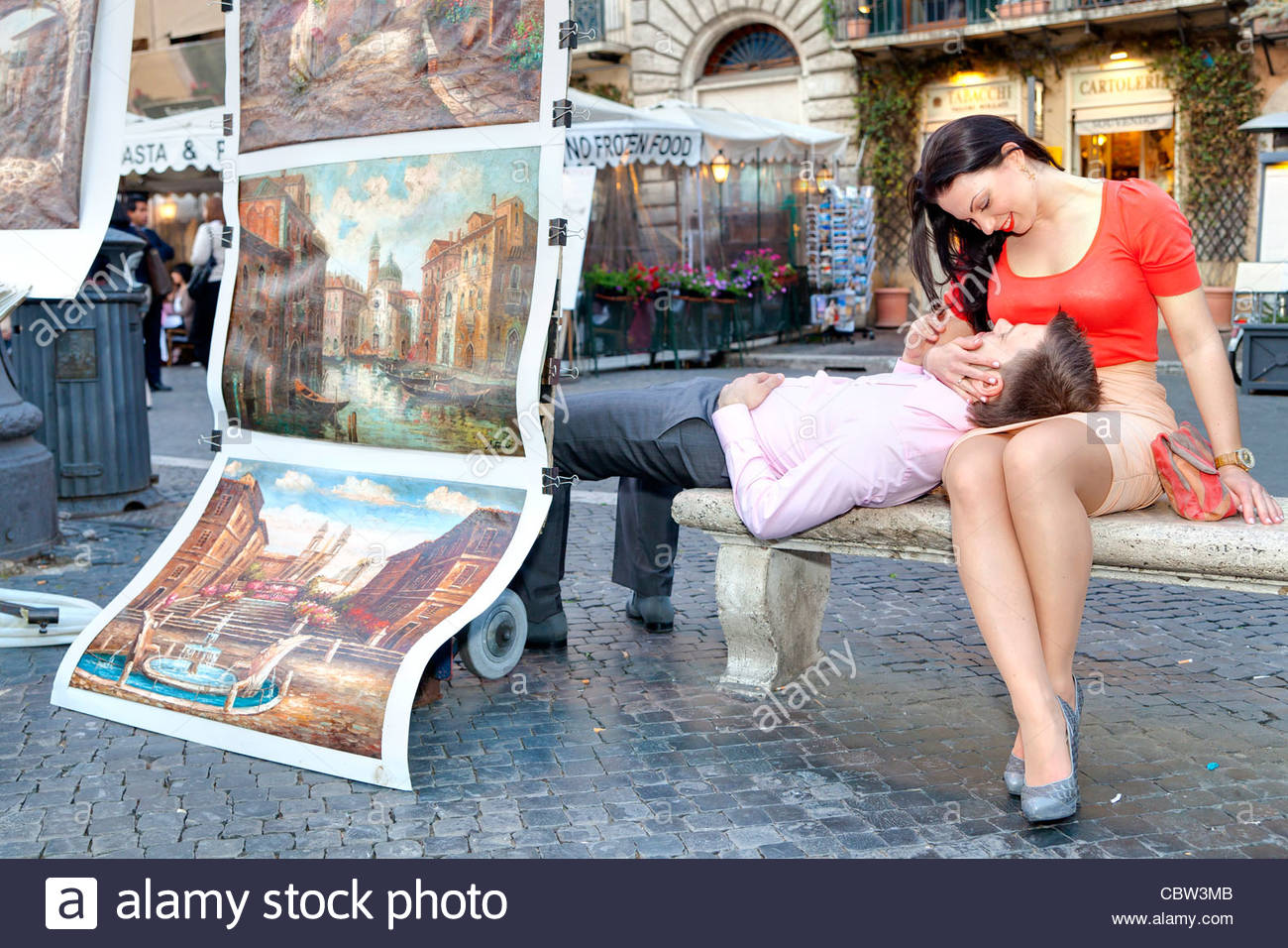 Couple sitting in Piazza Navona Rome Italy - Stock Image