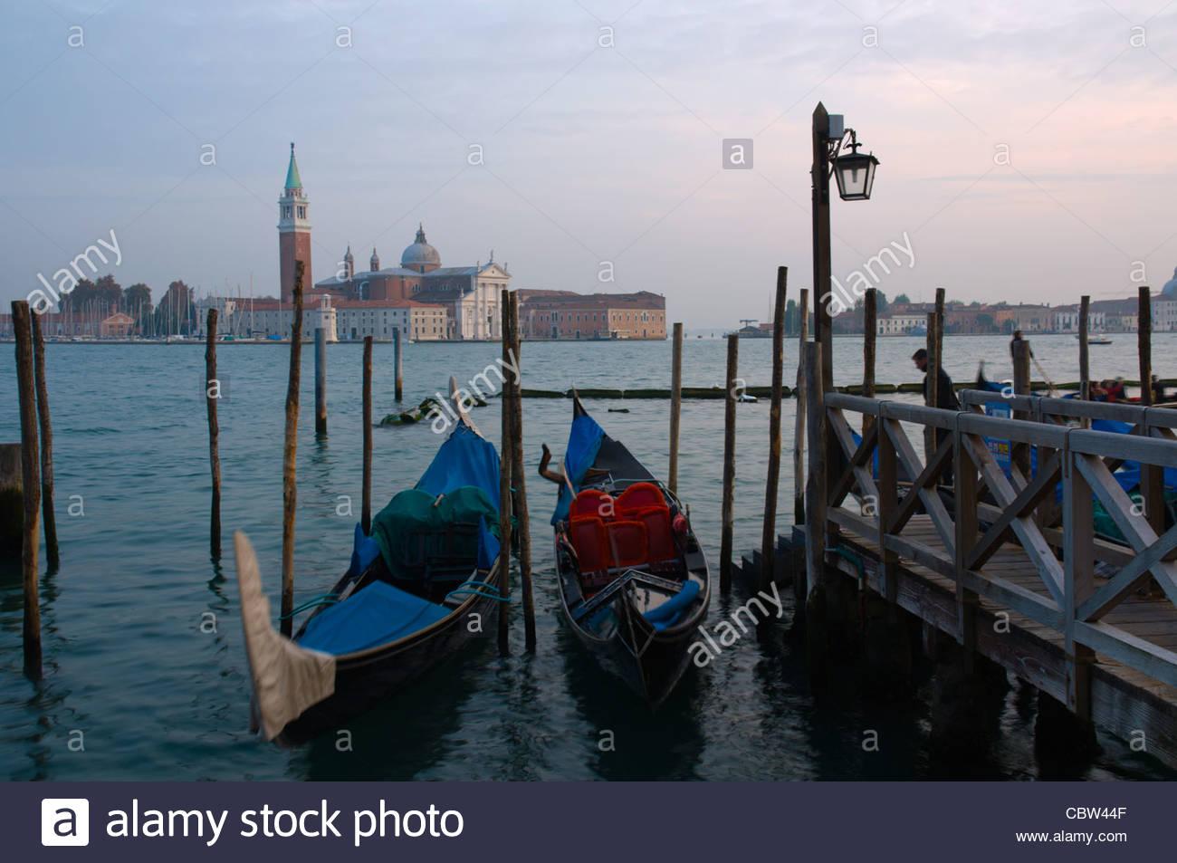 Gondolas swaying in the wind at Bacino di San Marco bay Venice the Veneto region northern Italy Europe - Stock Image