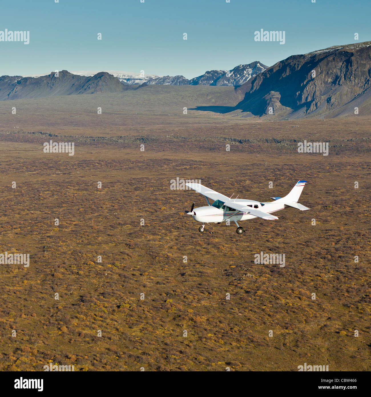 Cessna flying over South Coast Iceland - Stock Image