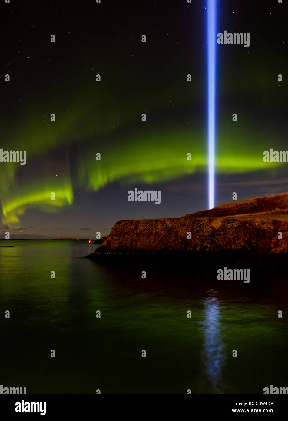 Aurora Borealis with Imagine Peace Tower light, Videy, Reykjavik, Iceland - Stock Image