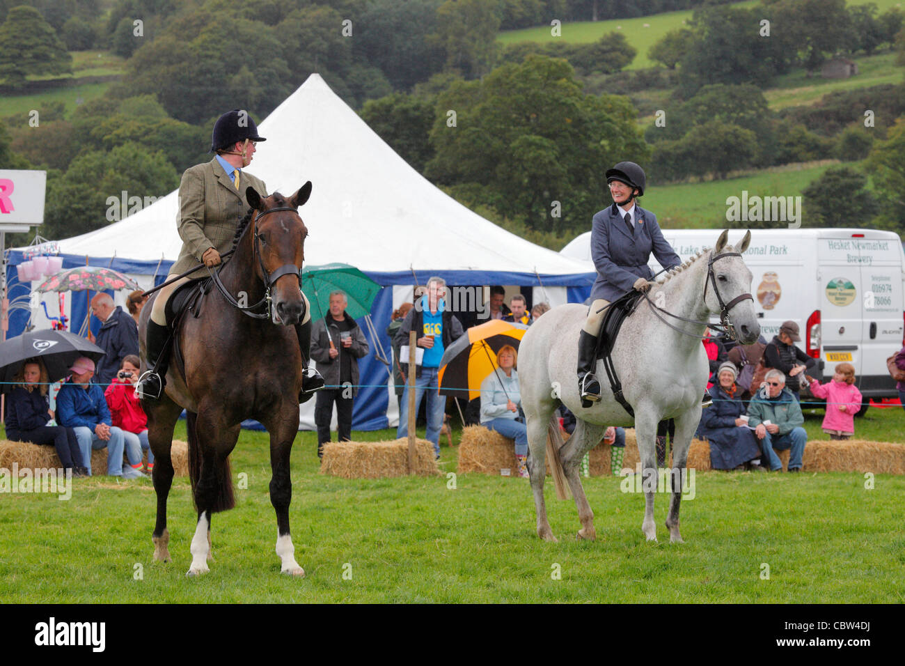 Two Horses and riders on the show ground at Hesket Newmarket Agricultural Society Show, Cumbria, England, UK - Stock Image