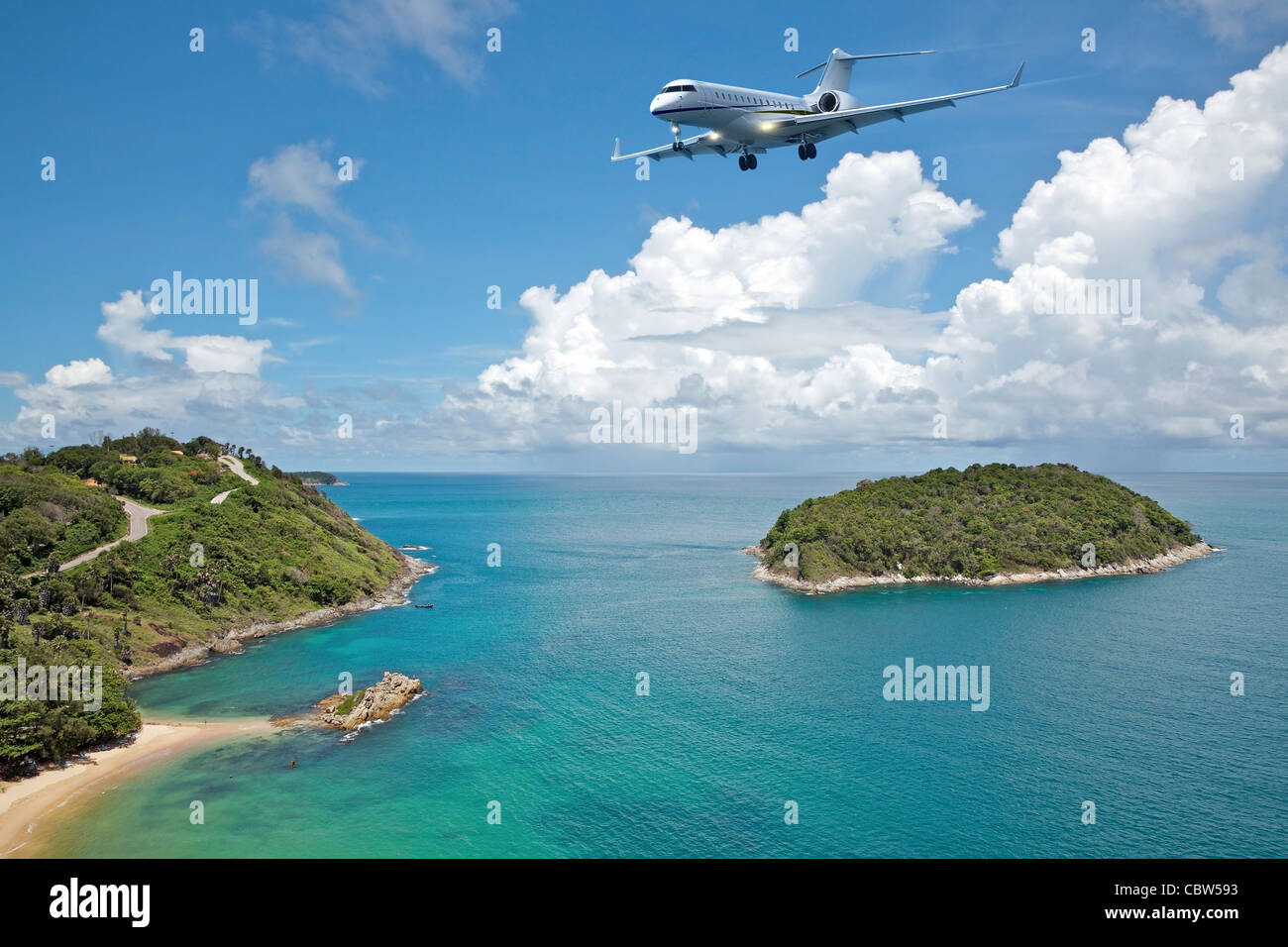 Private jet plane is going to land at the airport of a tropical island. Luxury style living concept. - Stock Image