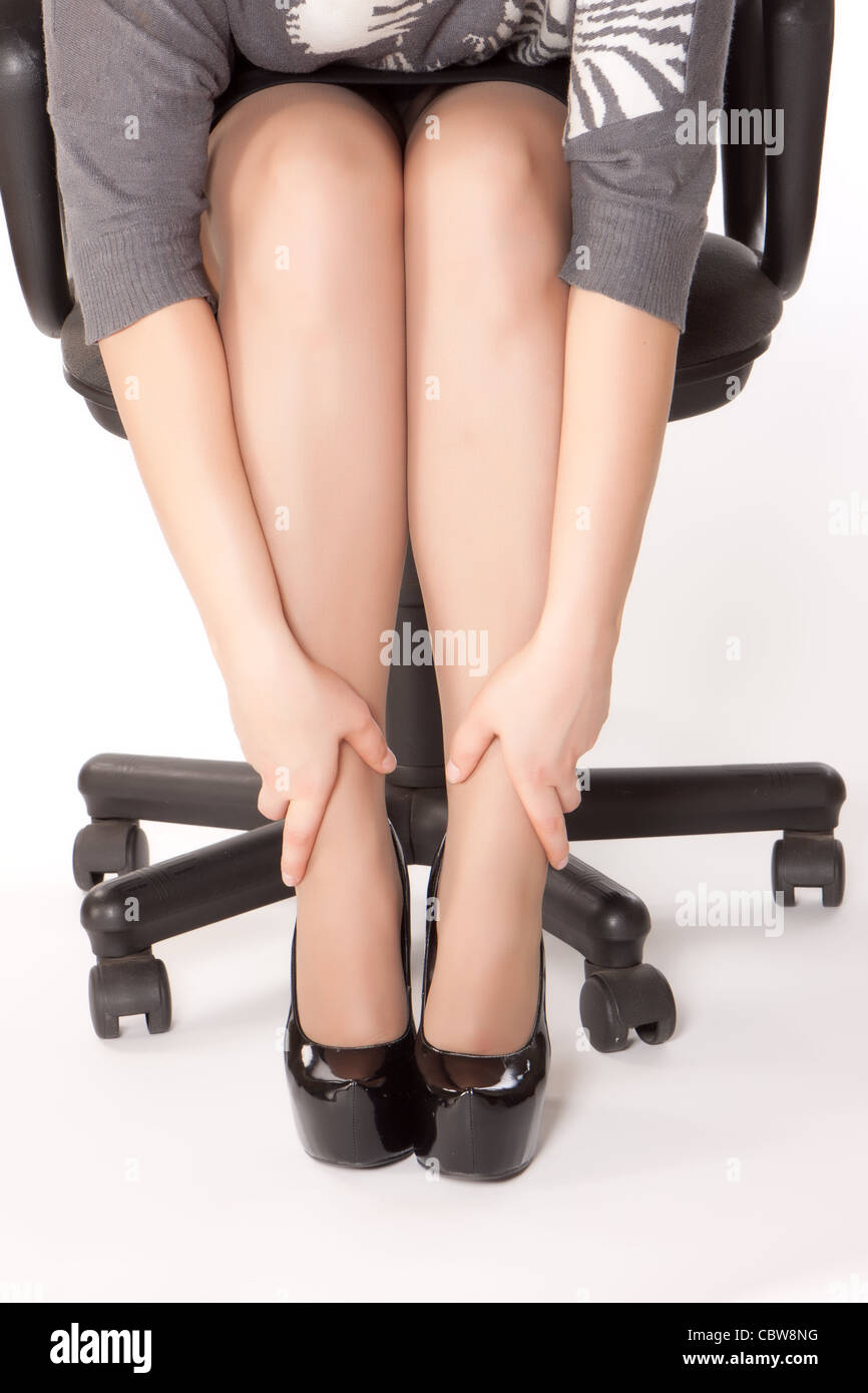 Woman Is Sitting In Chair And Massaging Her Tired Of Shoes Legs
