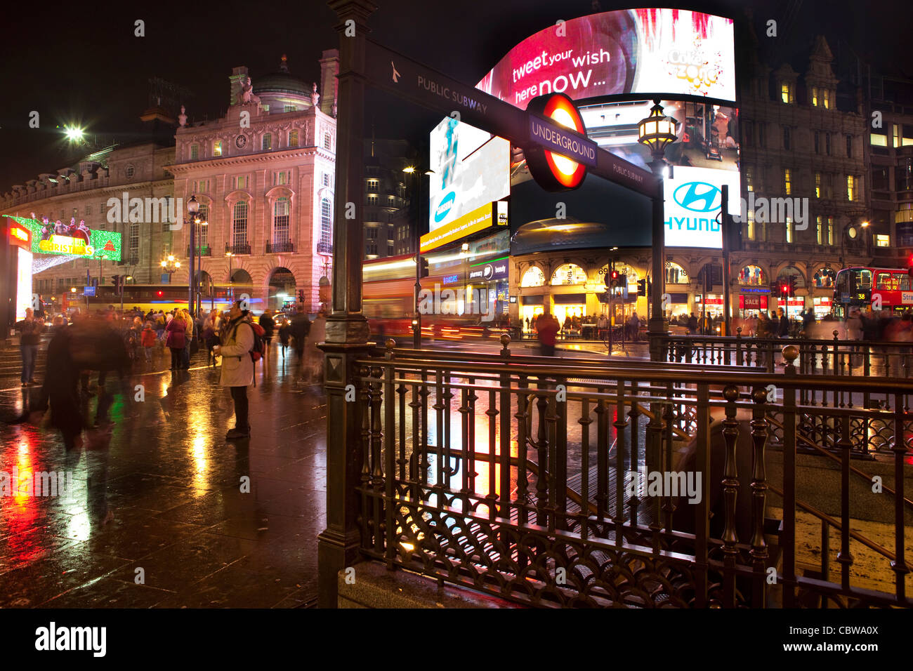 Piccadilly Circus in London at night time. - Stock Image