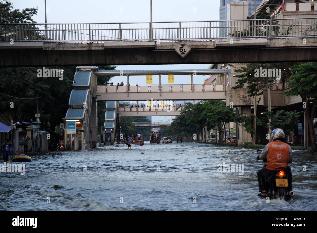 Floodwater on street in Bangkok Stock Photo