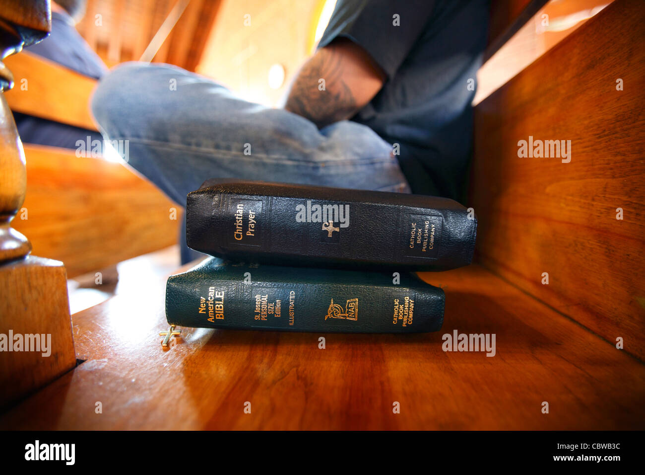 Bibles on a bench next to a prisoner in the Dominican lay program, Massachusetts Correctional Institute, Norfolk, - Stock Image