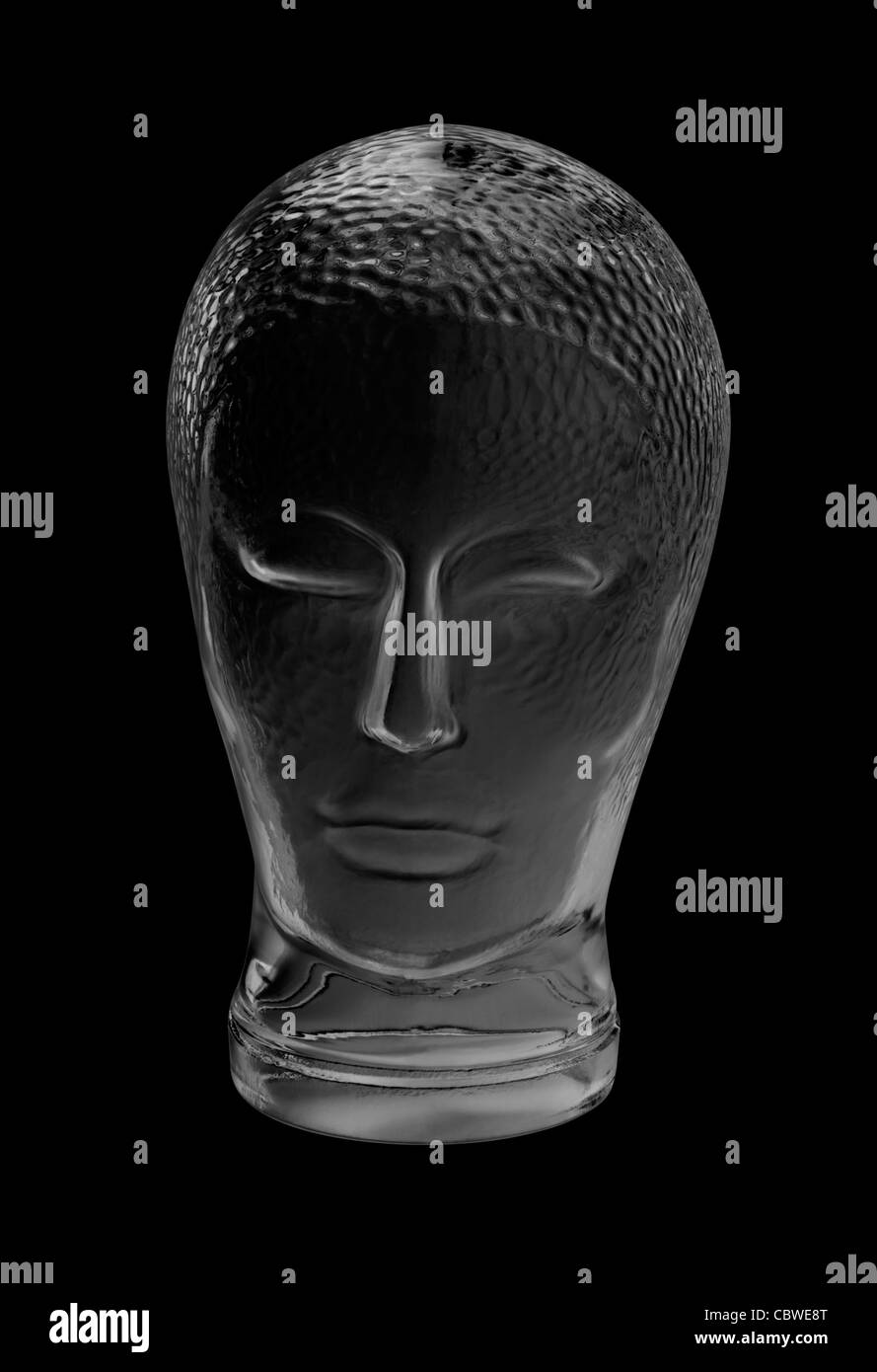 human head made of glass in black back - Stock Image