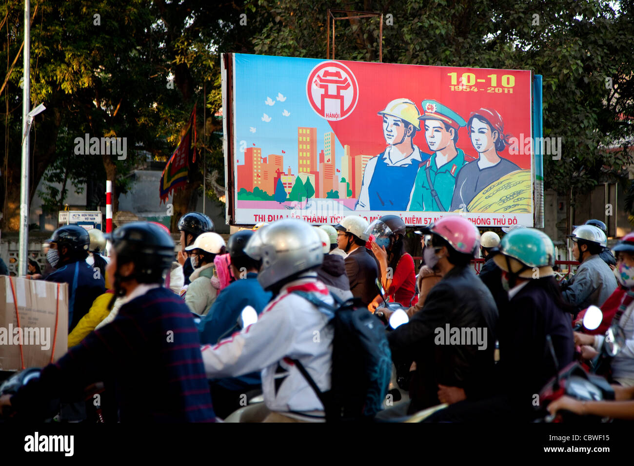 Propaganda sign and traffic in Hanoi, Vietnam, Asia - Stock Image