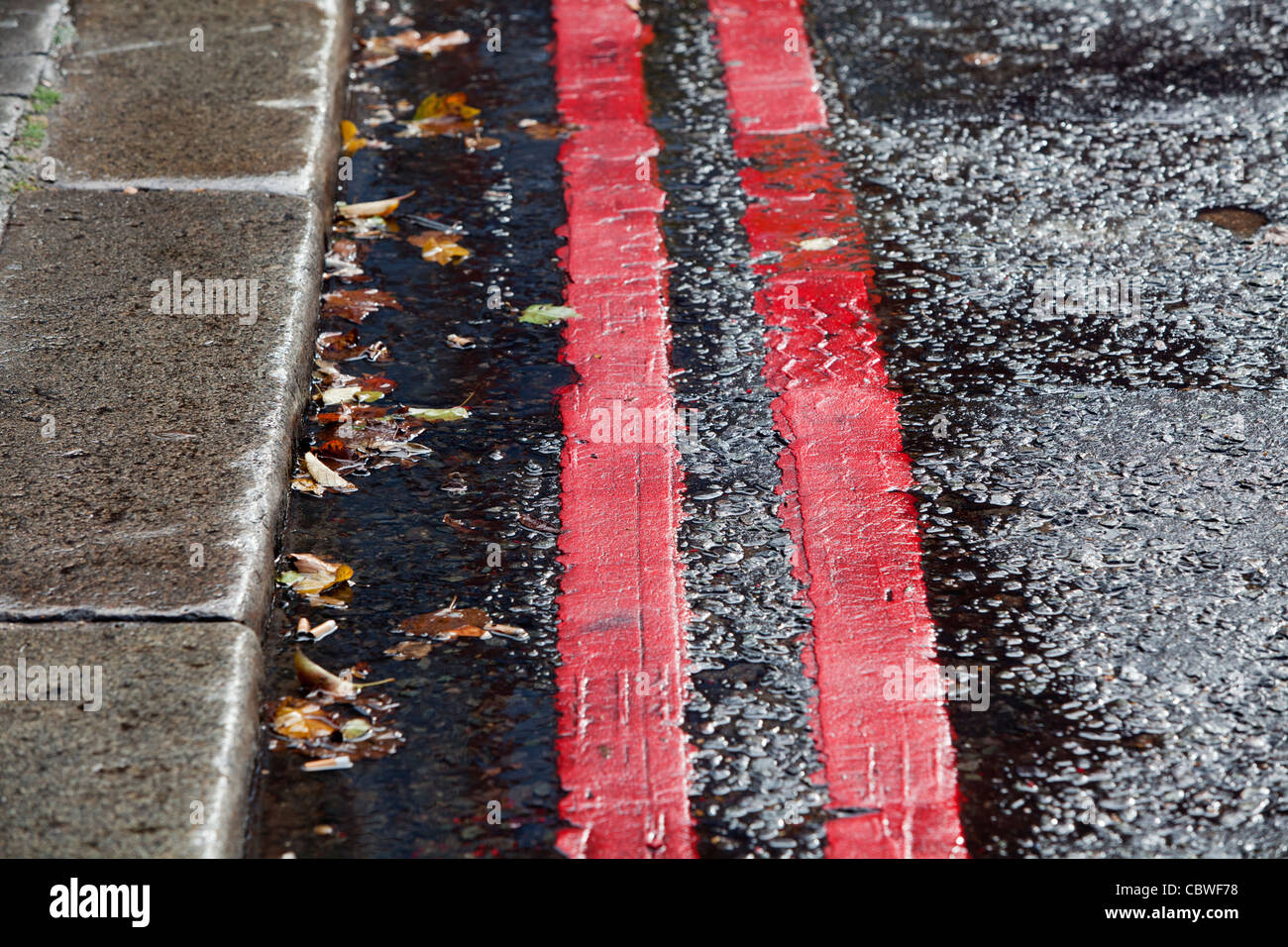Double red lines on a no stopping route in London, UK. - Stock Image