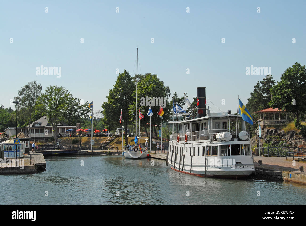 Cruising the Göta Kanal, MS Juno passes Trollhättan lock and docks at the upper bassin - Stock Image