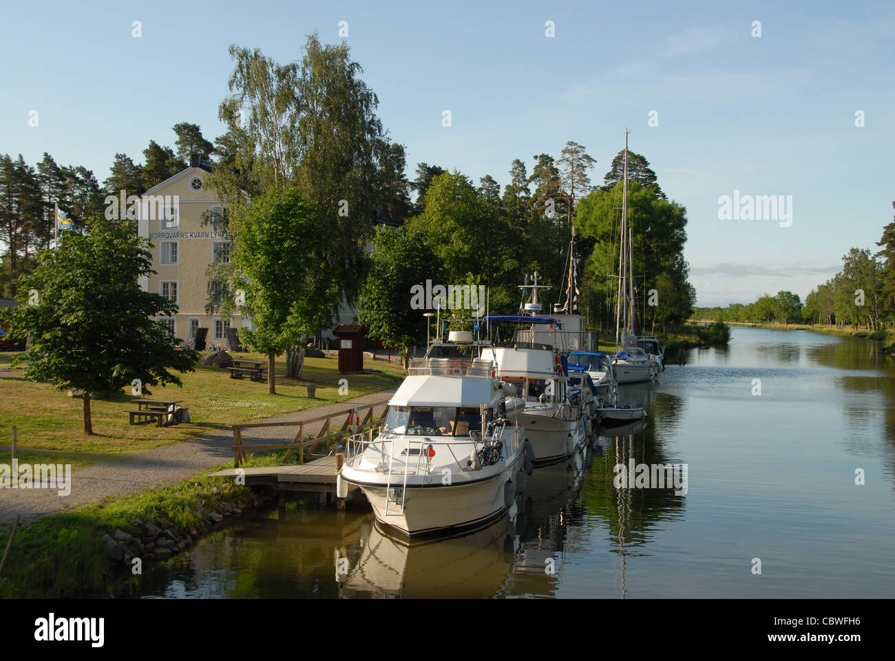 Yachts moored at the quay of Lyrestad on the Göta-Kanal in central Sweden - Stock Image
