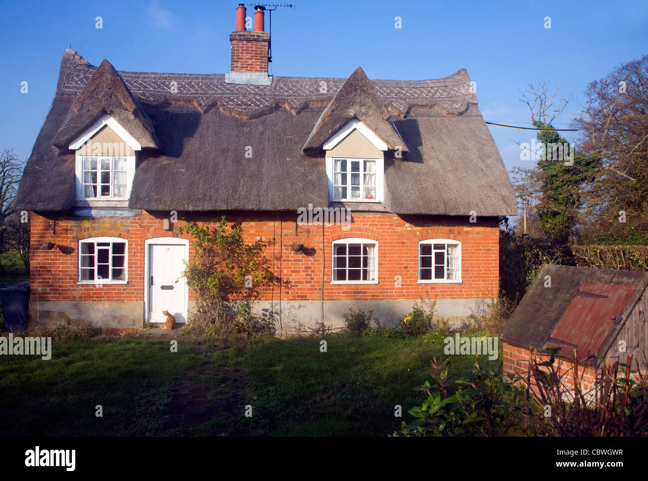 Detached red brick stock photos detached red brick stock for Country cottage kennel