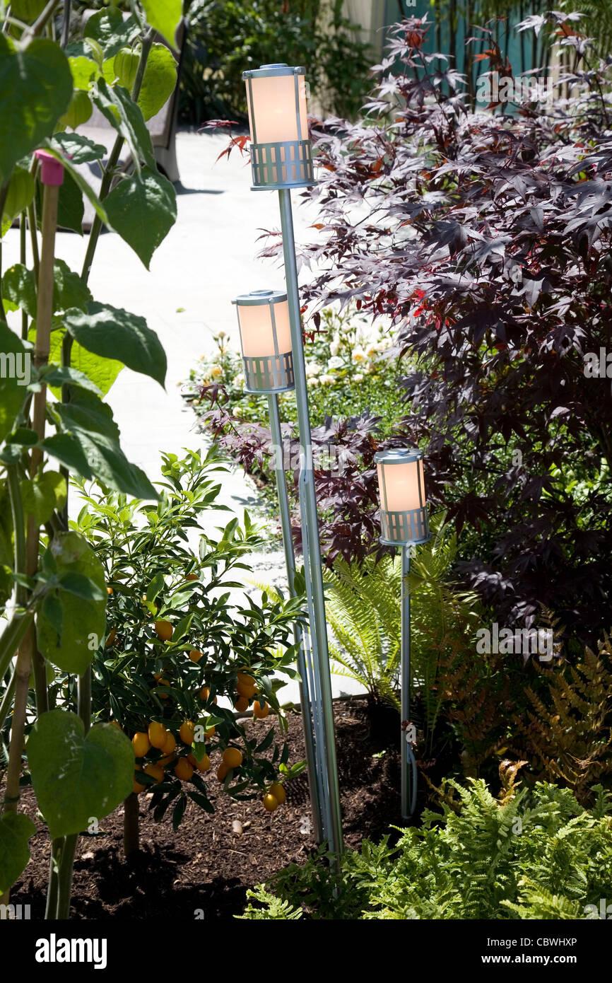 Contemporary garden lights in a border - Stock Image