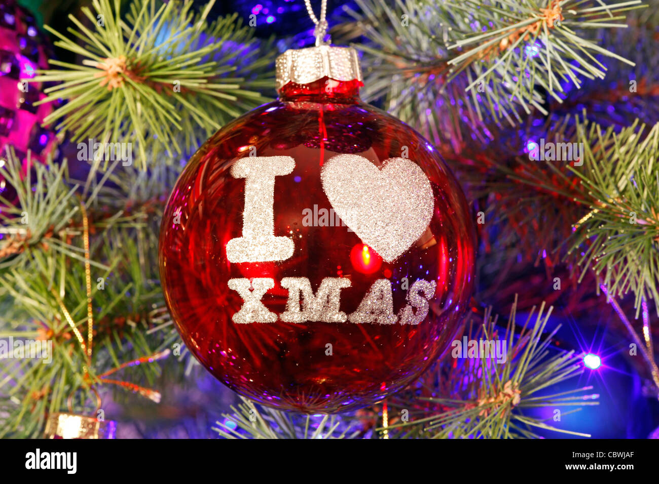 i love xmas bauble and christmas decorations with lights on a xmas tree stock image