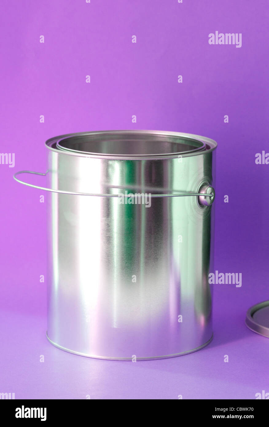 open can of paint on purple background - Stock Image
