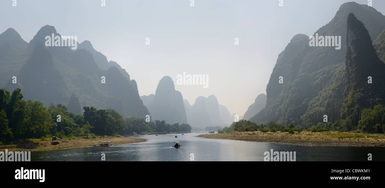 Panorama of the Lijiang River surrounded by tall limestone peak Karst formations Peoples Republic of China - Stock Image