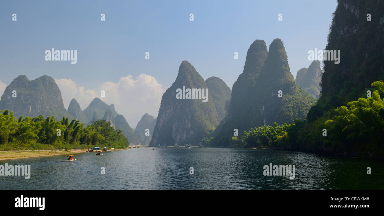 Panorama of bamboo forest and tall karst peaks along the Lijiang River Guangxi province Peoples Republic of China - Stock Image