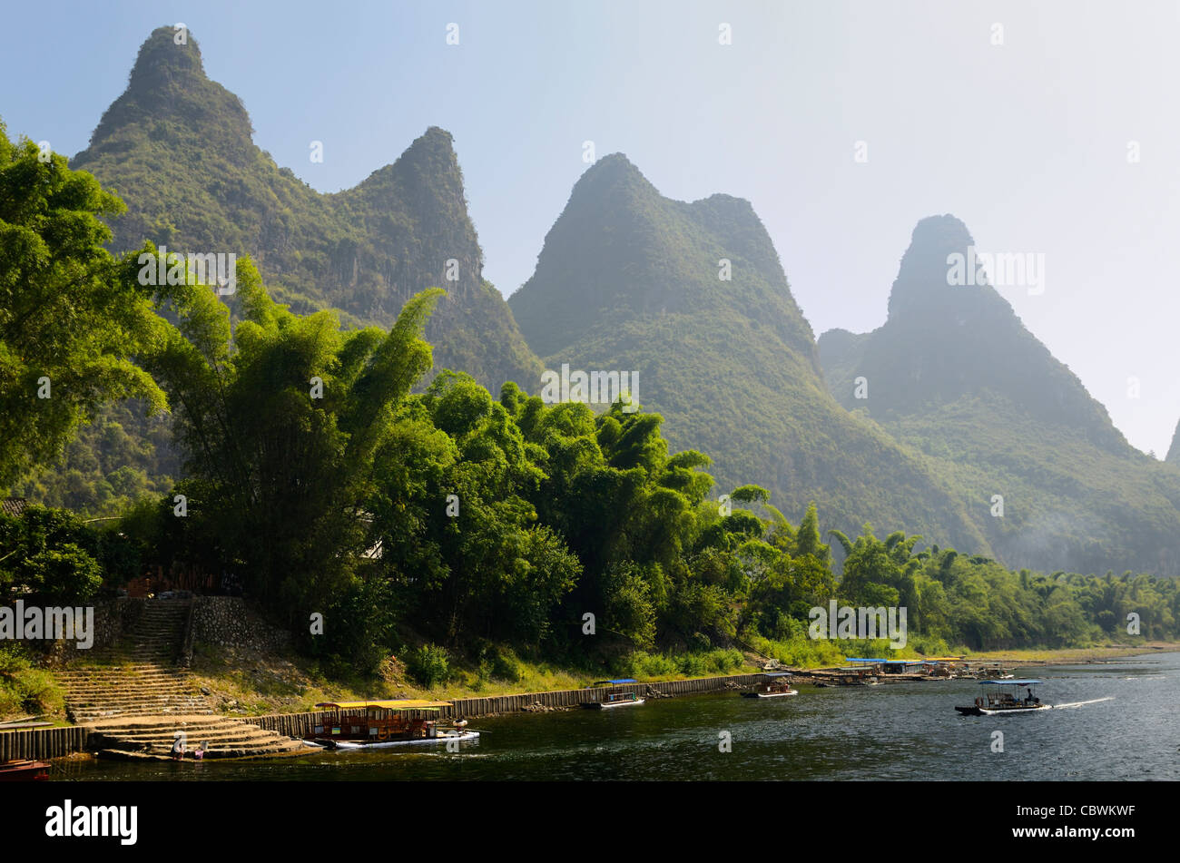 Steps to the Li river Guangxi Peoples Republic of China with fingerlike karst mountain peaks and bamboo forest Stock Photo