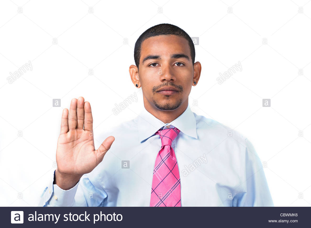 Hispanic man taking oath or pledge - Stock Image
