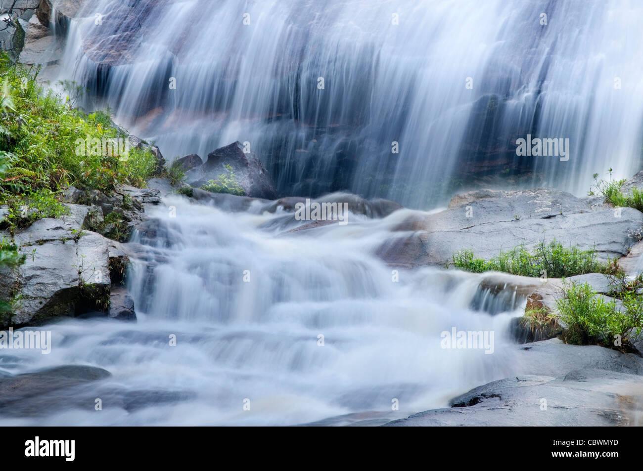 Natural waterfall at Gunung Stong State Park, Kelantan, Malaysia - Stock Image