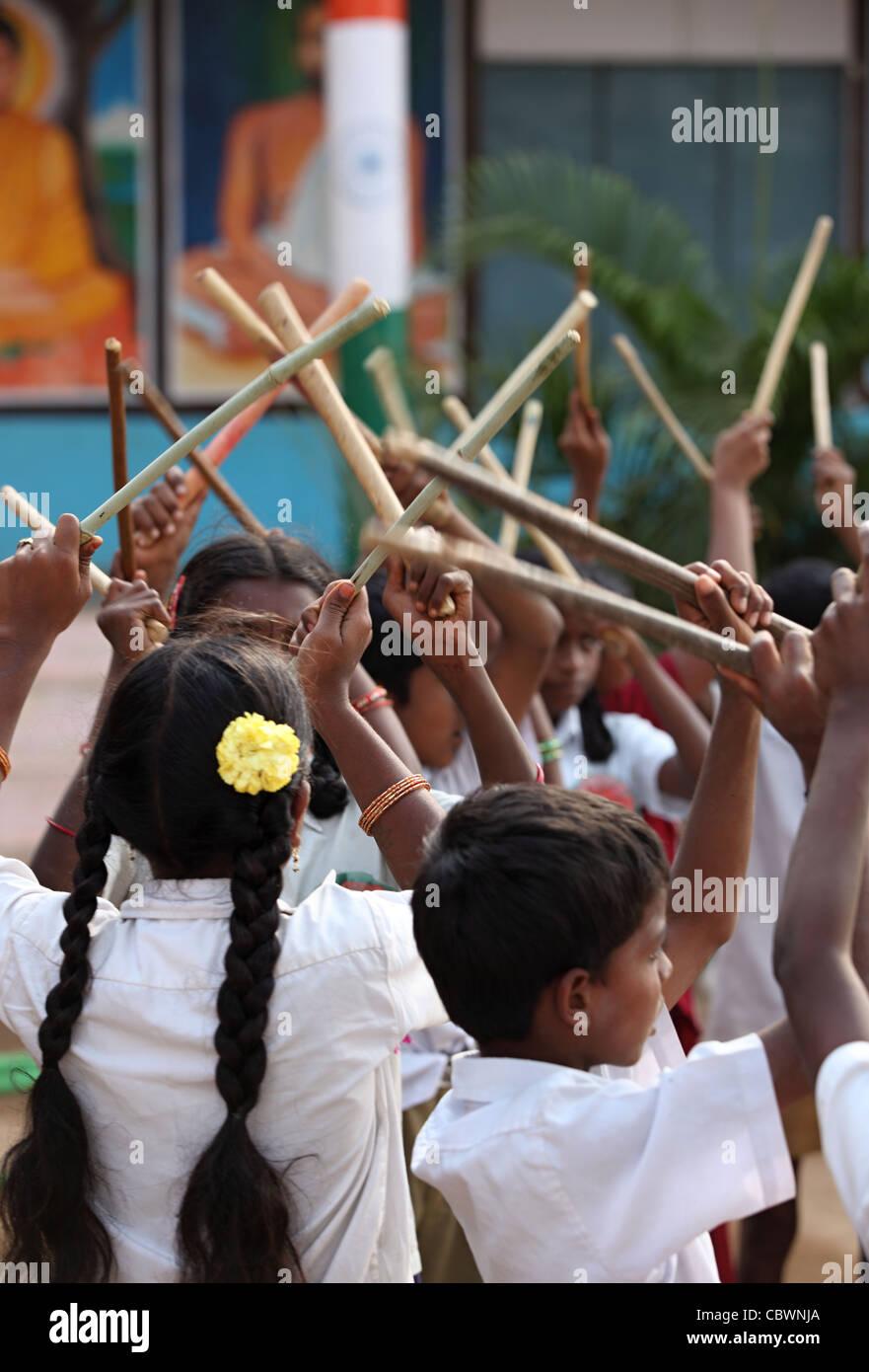 school children dancing and singing Andhra Pradesh South India - Stock Image
