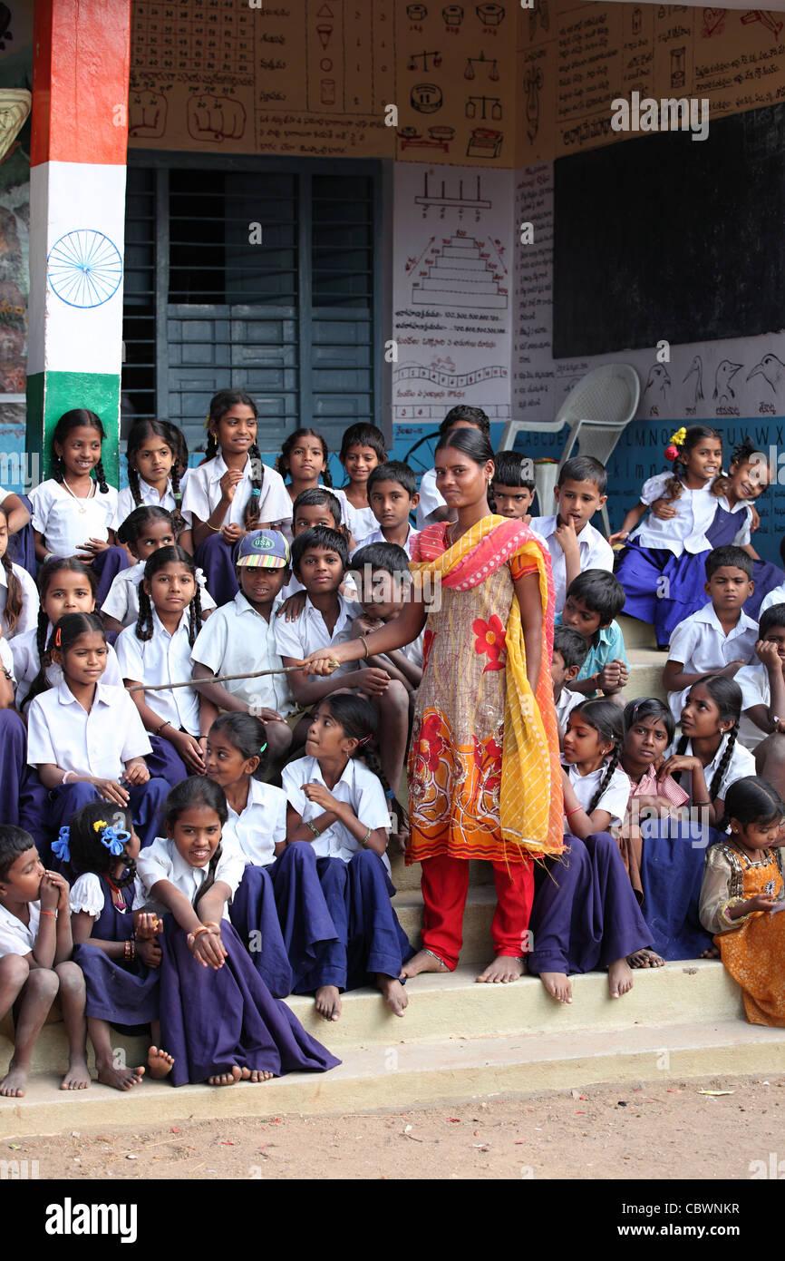 School helper with children Andhra Pradesh South India - Stock Image