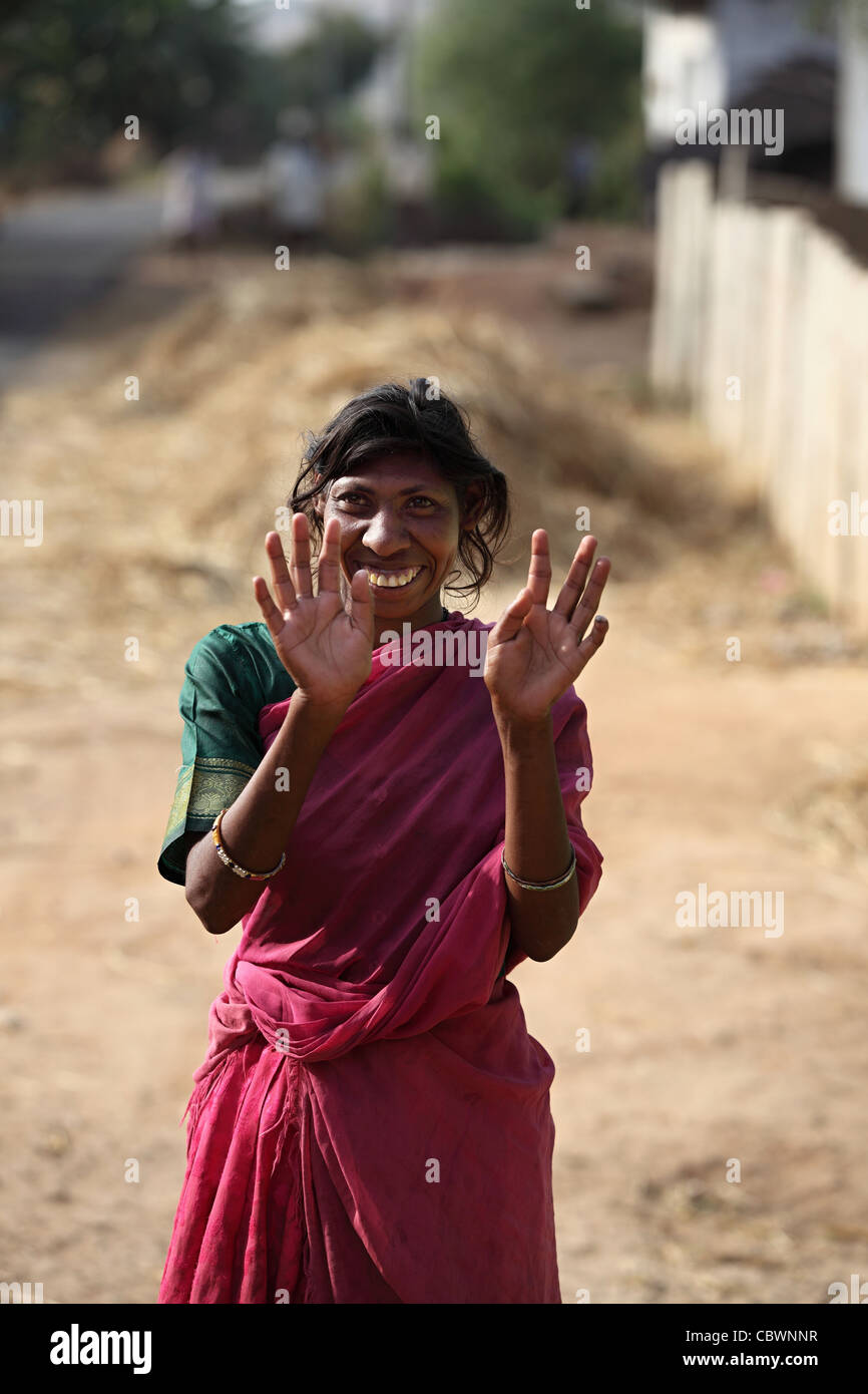 Mentally impaired and amazingly sweet woman Andhra Pradesh South India - Stock Image