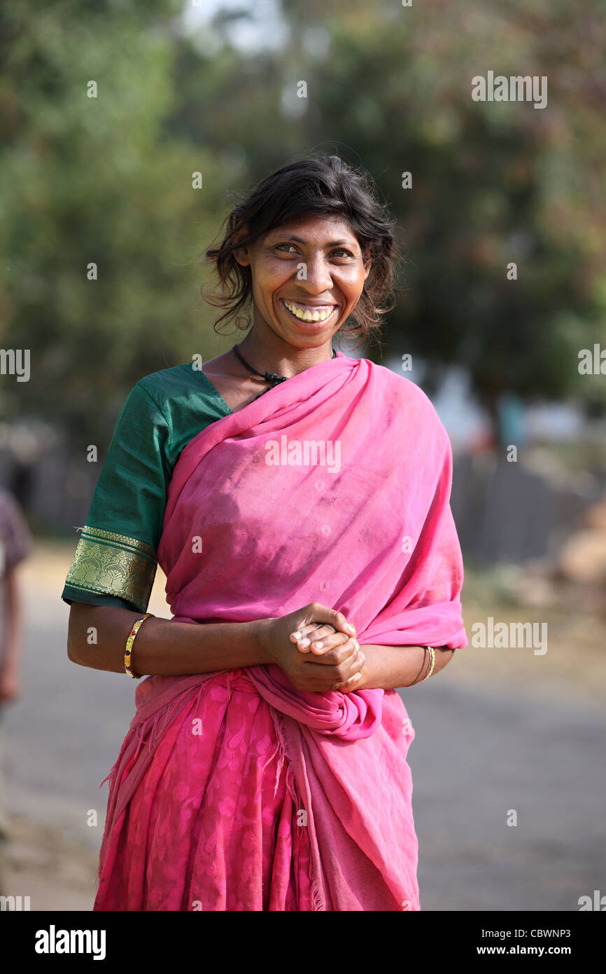 Mentally impaired and amazingly sweet woman in Andhra Pradesh South India - Stock Image
