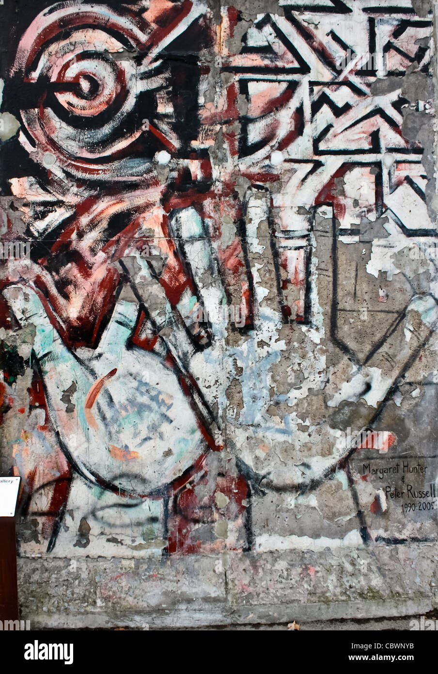 Graffiti on the East Side Gallery of the Berlin Wall representing hands - Stock Image