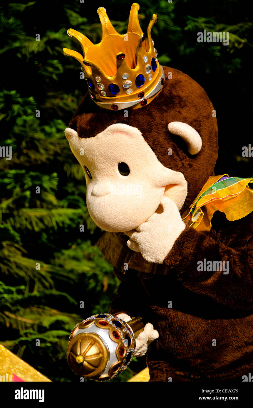 Portrait of Curious George cartoon character in Mardi Gras crown at Universal Studios Orlando Stock Photo